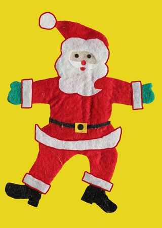 Santa Claus figure isolated on yellow background photo