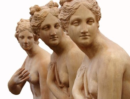 Sculptures of 3 graces  in  terracotta isolated on white, from tuscan town Impruneta near Florence                      Stock Photo