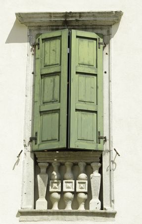 window with green shutter in Italy Stock Photo - 8060076