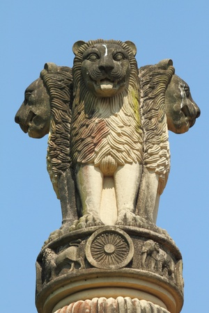 headed: sculpture of emblem of India, four lions (one hidden from view) - symbolizing power, courage, pride and confidence - rest on a circular abacus,park in Malabar Hill, Mumbai  Stock Photo
