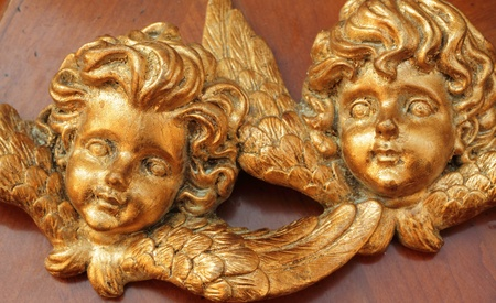 angelic faces carved in wood and gold painted photo