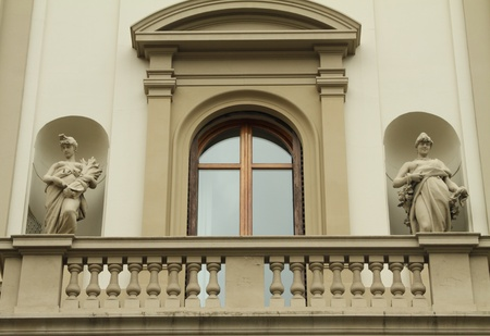 balcony design: elegant window and balcony framed with artistic decoration on historic building in Florence, Italy Stock Photo