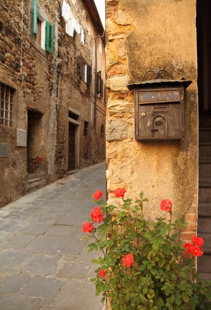 courtyard: old mailbox and rose on tuscan alley , Italy Stock Photo