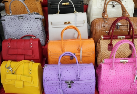 costly: colorful elegant leather hand bags collection, Italy  Stock Photo