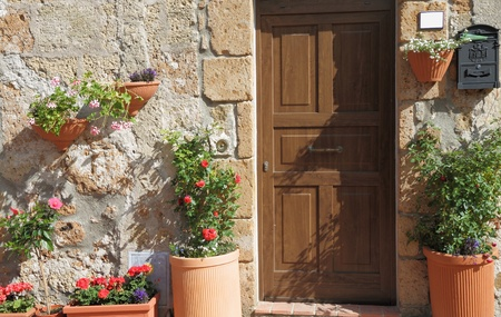 mediterranean style: sunny flowery entrance in Italy Stock Photo