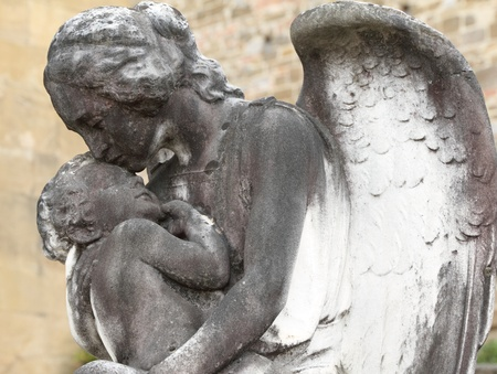 angel and child- antique sculpture on cemetery photo