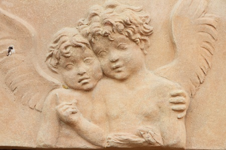two angels relief in terracotta, Impruneta, Tuscany, Italy  photo