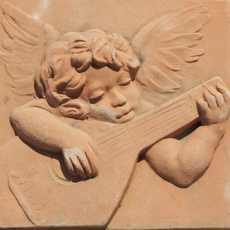 terracotta: angel playing guitar in terracotta from famous tuscan Impruneta, Italy