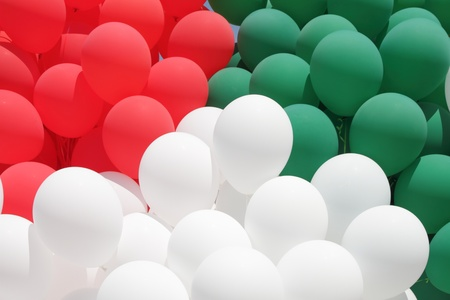 italian politics: red, green and white balloons - colors of Italy