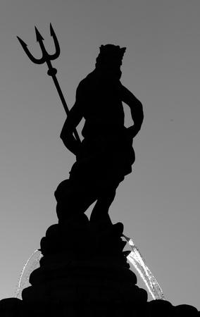poseidon: silhouette of Neptune with trident - fountain in Trento, Italy
