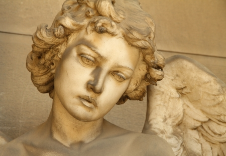 monumental: artistic sculpture of angel ,Monumental Cemetery of Staglieno, Genoa, Italy Stock Photo