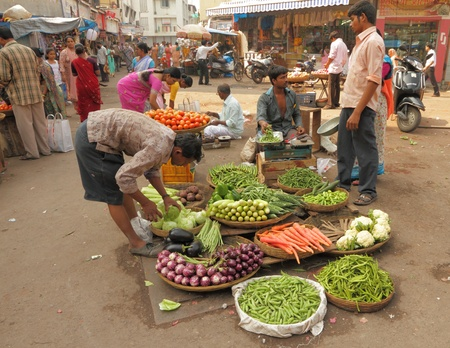 the stalls: MUMBAI, INDIA - NOVEMBER 27: Typical vegetable street market in India on 27november, 2010 in Mumbai, India. Food hawkers in India are generally unaware of  standards of hygiene and cleanliness. Editorial