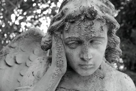 monumental cemetery: pensive angelic figure, sculpture on Monumental cemetery of Staglieno, Genoa,Italy,Europe