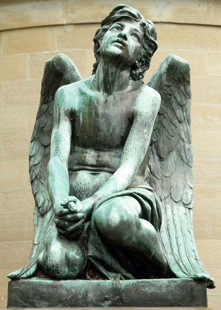 angel headstone:  antique bronze sculpture of wistful angel, monumental cemetery in Florence,Italy, Europe. Stock Photo