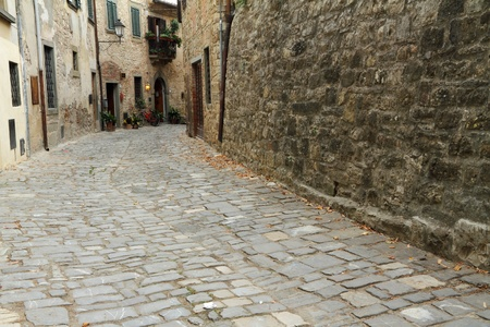 stony: stony antique narrow street in tuscan village Montefioralle, Italy, Europe Stock Photo