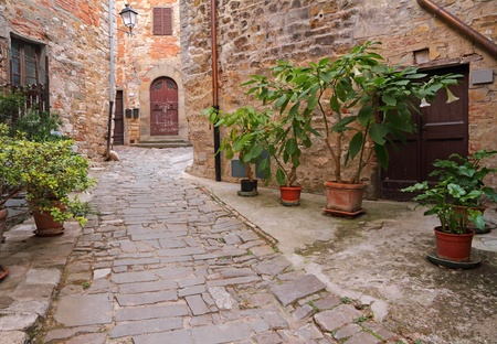 narrow italian street in village Montefioralle in Tuscany, Italy photo