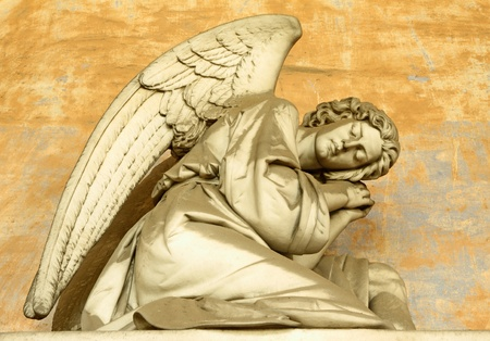 angel headstone: angelic figure on monumental historic cemetery in Staglieno, Genoa in Italy, Europe