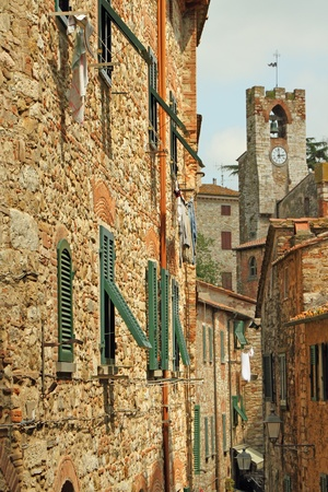 narrow street in antique tuscan village  Suvereto, Italy, Europe photo