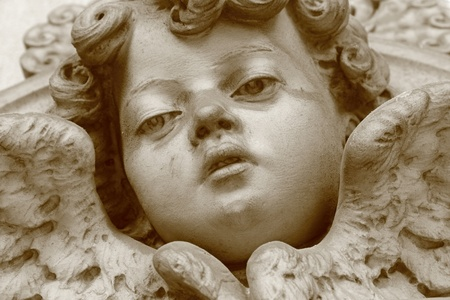 angelic face, cemetery sculpture photo