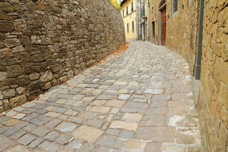 narrow curve street in italian village Montefioralle, Greve in Chianti, Tuscany, Italy, Europe photo