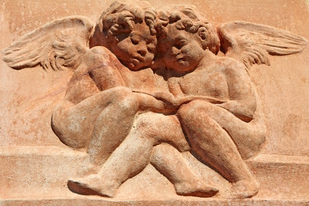 two angels - decor in tuscan terracotta, Italy photo