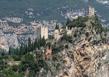 burg: Castle on limestone cliff in Arco in Trentino, Italy, Europe Stock Photo