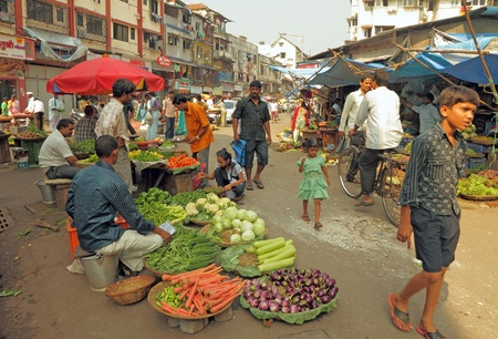 poverty india: MUMBAI, INDIA - NOVEMBER 27: Typical vegetable street market in India on Nov. 27, 2010 in Mumbai, India. Food hawkers in India are generally unaware of standards of hygiene and cleanliness. Editorial