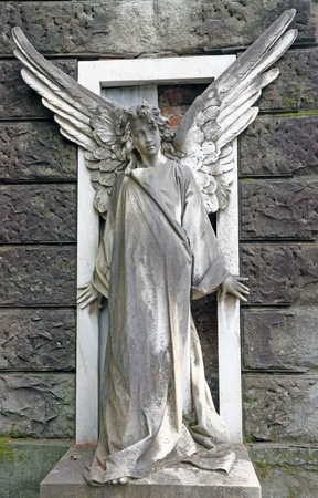 churchyard: antique cemetery angel on monumental cemetery in Florence, Italy, Europe