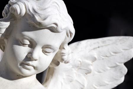 cemeteries: angel image  isolated on black Stock Photo