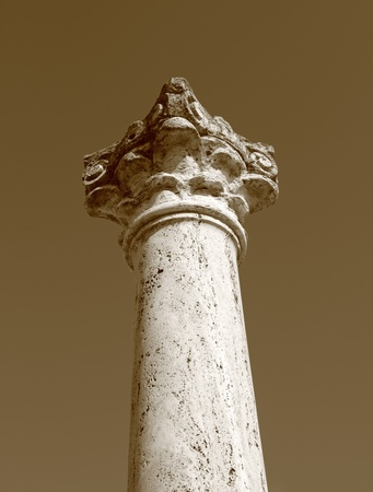 vintage photo in sepia of ancient column photo