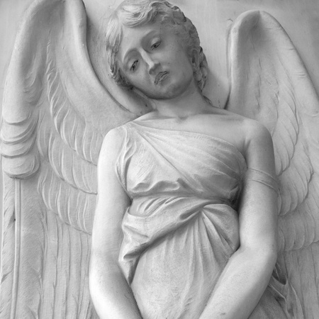 monumental cemetery: sad cemetery angel relief on monumental italian churchyard,Staglieno Genoa, Italy, Europe
