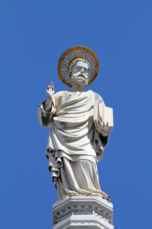 saint marco: Mark the Evangelist  marble figure on rooftop of the Basilica San Marco in Venice, Italy, Europe