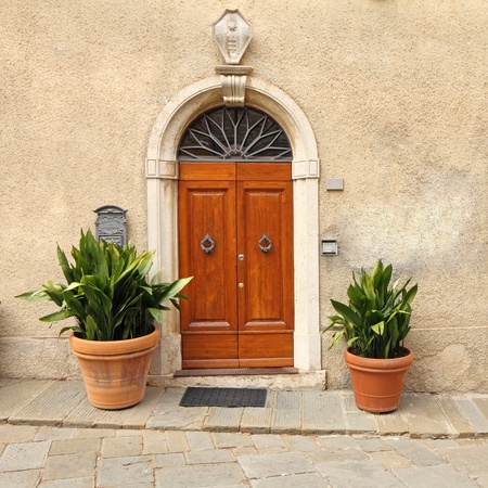 french doors: elegant front door to the tuscan house, Italy Editorial