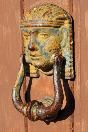 beautiful antique knocker, Tuscany, Italy, Europe  Stock Photo - 13794412