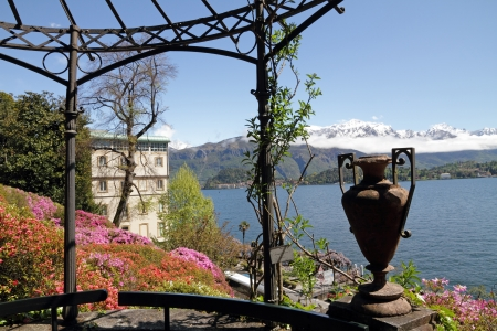 spectacular view from historic Garden of Villa Carlotta of lake Como and snow mountains on horizon, Tremezzo, Lombardy, Italy, Europe