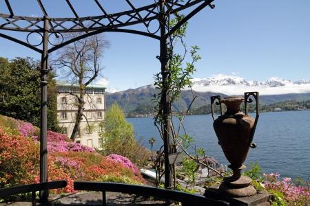 spectacular view from historic Garden of Villa Carlotta of lake Como and snow mountains on horizon, Tremezzo, Lombardy, Italy, Europe