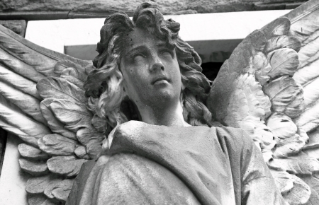 monumental cemetery: detail of angelic figure on monumental cemetery in Florence, Italy, Europe  Stock Photo