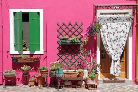 colorful front door to the house on venetian island Burano, Veneto, Italy, Europe