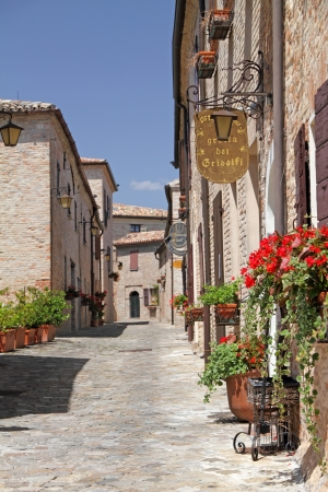 pictorial: pictorial narrow paved street in village Montegridolfo in province of Rimini, Emilia-Romagna, Italy, Europe Editorial