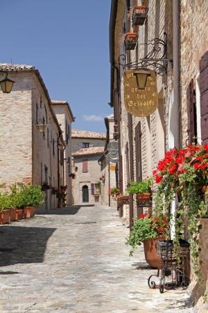 cobblestone street: pictorial narrow paved street in village Montegridolfo in province of Rimini, Emilia-Romagna, Italy, Europe Editorial