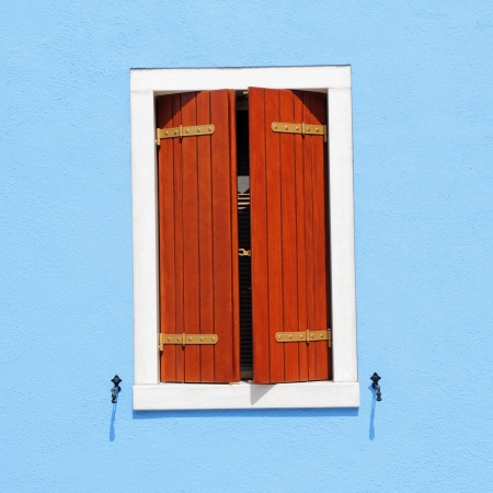 detail of colorful facade with window with ajar shutters, Burano, Venice, Italy, Europe photo