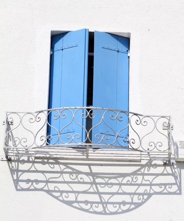 window with azure shutters and wrought flower container, Burano, Venice, Italy, Europe photo