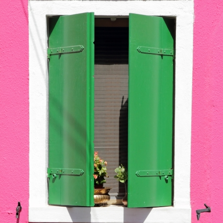 colorful window in Burano village, colorful houses are typical for this borgo, Italy, Europe photo