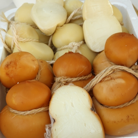 calabria: Caciocavallo cheese on italian farmer market, Florence, Tuscany, Italy