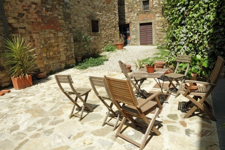 garden furniture on tuscan backyard, Italy, Europe photo