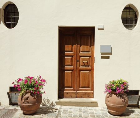 elegant doorway to the  house with terracotta containers for blooming plants, Emilia - Romagna,Italy, Europe photo
