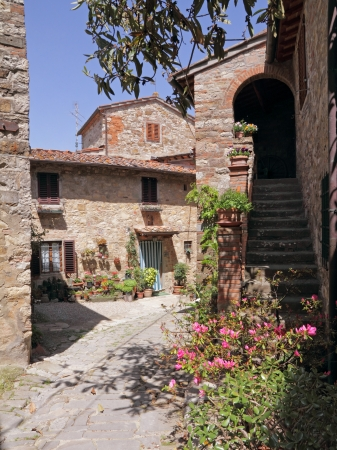 courtyard: pictorial courtyard in tuscan medieval village Montefioralle near Greve in Chianti , Italy, Europe Stock Photo