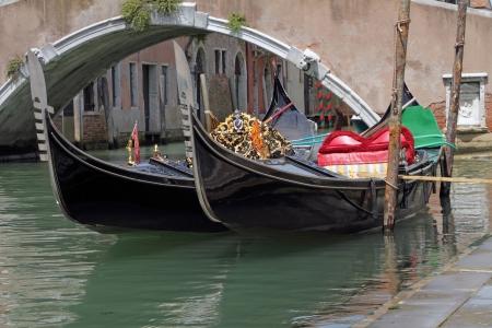moored: gondolas moored on canal, Venice, Italy, Europe Stock Photo
