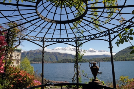 lake como: fantastic landscape of lake Como ( Lago di Como called also Lario) seen  from gazebo in historic Garden of Villa Carlotta, Tremezzo, Lombardy, Italy, Europe