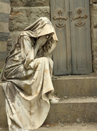 angel headstone: grief, tombstone on monumental cemetery in Florence, Italy, Europe